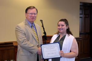 Dr. Summers gives the Leadership Award in International Studies to Melissa Faith Noe.