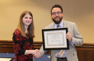 Dr. Splawn gives the Albert F. and Sophronia Winham Ramsey Memorial English Scholarship to Dallas Richardson.