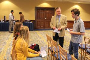 Dr. Summers visits with students.