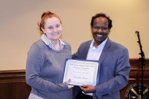 Dr. Nandamudi gives the Promise Award in Political Science to Danielle Reeves.