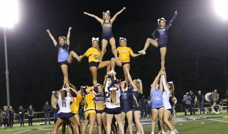 ETBU Tiger Cheer builds a pyramid at the Tiger Pep Rally on Friday evening. The student-led pep rally also featured performances by Tiger Pom and the ETBU Band.
