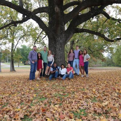 Group of students under tree on preview day